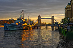 Sunrise (Croydon Clicker) Tags: ship warship historic boat bridge towerbridge dawn daybreak sunrise river water reflections embankment buildings sky cloud london thames nikon nikkor