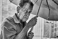 man with umbrella (rainerneumann831) Tags: bw blackandwhite street strase streetphotography candid strasenfotografie monochrome urban ©rainerneumann riodejaneiro wwwrainerneumannphotographyde mann regenschirm portrait