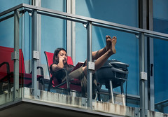 Chillin' (Canadapt) Tags: woman balcony apartment feetup relaxed chair red toronto canadapt reading book bbq