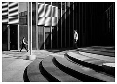 Lines of Sight (Dave Button) Tags: barcelona barceloneta mono monochrome fuji fujifilm bw street border grey grayscale tone shadow light photo urban city building architecture art lines curves diagonal vertical 27mm xe2s