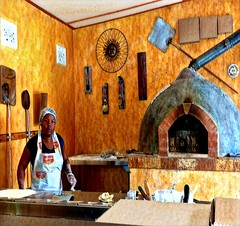 the provider of pizza (CatnessGrace) Tags: sliderssunday hss restaurant kitchen pizza yellow people decor urban