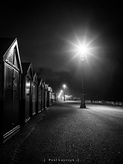 Hove Seafront (amipal) Tags: 175mm autumn beachhut city england gb greatbritain hove manuallens night sussex uk unitedkingdom urban voigtlander wet windy