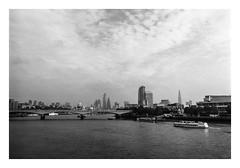 FILM - London from the Golden Jubilee bridge (fishyfish_arcade) Tags: 35mm 800asa analogphotography bw blackwhite blackandwhite filmphotography filmisnotdead hp5 istillshootfilm london monochrome olympusom1 zuiko28mmf35 analogcamera film ilford mono landscape riverthames boat
