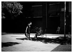 Friend or Foe? (Dave Button) Tags: mono monochrome fuji fujifilm bw street border grey grayscale greyscale tone light photo urban city art barcelona barceloneta catalunya catalonia catalan xe2s xe2 silverefexpro people