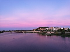Pink hour (Joost (formerly habeebee)) Tags: spain extremadura badajoz guadiana river sunset town reflection pink blue bridge alcazaba