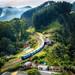 photo-of-railway-on-mountain-near-houses-1658967