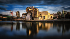 Guggenheim Museum Bilbao - Spain (Patrik S.) Tags: ngc sony a7m3 a7iii alpha spain bilbao bizkaia travel northern passengers sack station houses colorful floor deep down ticket city citylife skyline riding time people day casas ciudad viaje españa museum guggenheim new york art river bridge blur museo arte rubor puente longexposure long exposure larga exposición largaexposición reflection reflexión roja rojo red cielo nubes nublado palma blue azul famosa famous tourist tourista attraction atracción difuminar water agua sunset puesta de sol puestadesol dorada golden