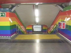 Chueca  Metro Station, Chueca, Madrid, Spain (d.kevan) Tags: rainbow station metro chueca lbgt passages steps madrid gayfriendly poster advert lights handrails