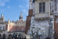 Main Market Square, Krakow, Poland (Cat Girl 007) Tags: ancient architecture blue building cathedral centre church city cityscape cloth cracow europe european exterior face famous hall historical krakow landmark main market mask medieval old poland polish sculpture sky square sukiennice tourism tower town travel urban