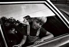 Portrait of a friend's son, 1980, Ellicott City, Maryland (A CASUAL PHOTGRAPHER) Tags: portraits children automobiles cars kids ellicottcity maryland trix kodak analog film minolta srt101 1980s
