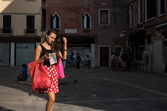 Navigating Venice (Silver Machine) Tags: italy venice streetphotography street candid softlight polkadotdress map mobilephone sunlight girl walking fujifilm fujifilmxt10 fujinonxf35mmf2rwr