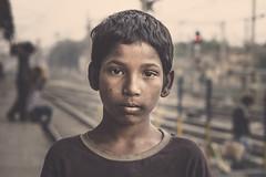 train platform meeting -- 2 (andy_8357) Tags: boy street portrait india varanasi train platform poverty sweet tender vulnerable uttar pradesh muted sony a6000 mirrorless alpha 6000 sigma 60mm f28 art dn people person young bokeh