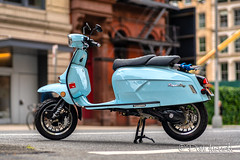 Scooter (Karlgoro1) Tags: carl zeiss planar t 1485 contax cy sony alpha a7r ii mirrorless digital camera ilce7rm2 manhattan new york city street windows architecture building sky skyscraper window lines reflections road bike scooter royal alloy