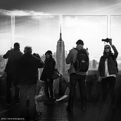 Top of the Rock (hervedulongcourty) Tags: photo square usa ciel nb manhattan rockefellercenter street gratteciel bw streetphotography cityscape skyscrapper sony sonnarte1824 citylife sky sonynex7 nyc empirestatebuilding silhouette carlzeiss squareformat topoftherock photography zeiss nex7 zeissselsonnart24mmf18za unitedstates blackandwhite carlzeisslenses city ngc sonyflickraward