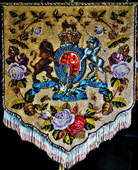 British coat of arms on a decorative hanging (Will S.) Tags: heraldry coatofarms british dieuetmondroit honisoitquimalypense ontario canada burlington mypics irelandhouse