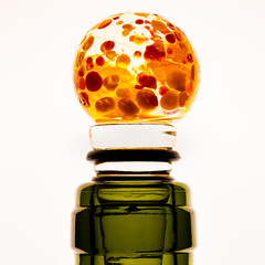 Colorful crystal bottle stopper for a wine bottle (FotoCorn) Tags: glass bottlestopper feuillemorte macromonday macromondays orange macro happymacromonday winestopper hmm2019 lids green happymacromondays hmm cap bottle