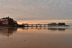 Cromer Pier. Norfolk, England. (Hidden in the flash.) Tags: cromer pier cromerpier norfolk england uk unitedkingdom nikon nikkor nikond500 d500 sunsetlight sunset reflection sea surf coast seaside beach alone peaceful tranquil