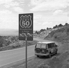 The Loneliest Road in America (fotobloki) Tags: monochrome bw blackandwhite hasselblad tmax400 kodaktmax400 road trip usa usaroadtrip ontheroad hasselbald carlzeiss filmphotography travelphotography analoguetravelphotography hwy50 theloneliestroadinamerica nevada middleofnowhere escapecampervan roadsign sign horizon