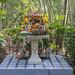 A Thai spirit house in Bang Kachao's Sri Nakhon Khuean Khan Park And Botanical Garden in Bangkok