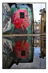 LONDON STREET ART by IRONY (StockCarPete) Tags: irony reflection puddle puddledouble streetart londonstreetart urbanart graffiti londongraffiti camden london uk window windoweye