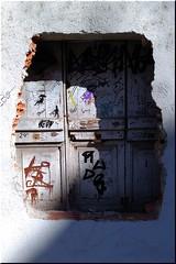 Very Strange Door (Perkriz) Tags: wall door house building girona spain perkriz