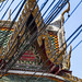 Wires and Wat Chimphli Sutthawat Buddhist temple on the island of Ko Kret in Nonthaburi near Bangkok in Thailand