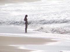 Papohaku Beach (thomasgorman1) Tags: beach shore woman silhouette tide water ocean pacific island molokai hawaii scenic tidal surge canon seascape