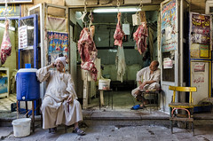 Butchery (Inaki Iglesias) Tags: aswan assuan assouan egypt market meat butchery butchers chair green pink yellow water cube rest resting street photography art life scene colours sigma nikon d7000 people zoco floor blue man men flesh fresh daily lights arab arabic phone calling world travel