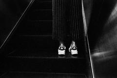 Adidas (ronn.aldaman) Tags: leicam5 rangefinder carlzeiss35mmf28biogon kodaktrix shoes escalator bw film analogue back stripes bangkokcityofangelsandangles xtol