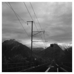On the Rails (Jamie Langford) Tags: switzerland railway interlaken blackandwhite blackwhite rolleiflex 120film tmax400 400iso analogue mountains sky grainy clouds cloudy overcast kodak
