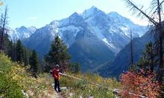 Hiking out (edenseekr) Tags: blue snowy mountains northcascadeswa wenatcheenationalforest hiking hiker snowline evergreens meadow