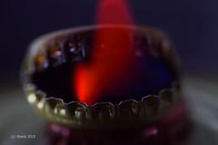 Lids on Fire (alternate) (Yberle.Foto) Tags: lids macro macromondays fire cap mostlyblack black red flame smoke tooth zähne metall