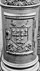 City coat of arms on a lampost, minus armourial bearers (Will S.) Tags: bw grey silver gray mypics escutcheon heraldry dublin ireland coatofarms motto