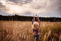 Spreading it in the wind (Elizabeth Sallee Bauer) Tags: nature active blond boy child childhood cute fall family field fresh fun gluten glutenfree grain grainfree happiness harvest kid outdoors outside playing youth