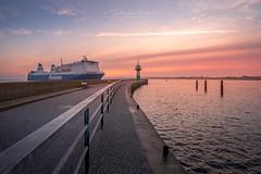 Finnlines arrive at sunrise (Michael Ke.) Tags: finnlines port vessel lighthouse leuchtturm travemünde batlic sea ostsee germany sunrise sonnenaufgang