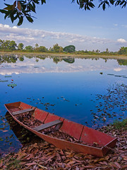 Reflections in Nong Ngaeng 2 (SierraSunrise) Tags: blue red sky clouds reflections thailand boat pond skies swamp nong esarn phonphisai isaan nongkhai