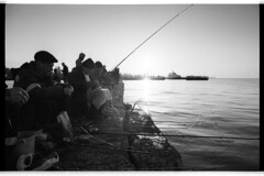 Goby fishing (Alimkin) Tags: 35mm 35mmphotography analogfilm analogphotography saveanalogcameras analog believeinfilm bw bnw blackandwhite monochrome adox silvermax city street streetphotography streetshot streetlife fisherman fishing