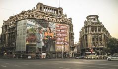 Consumerism (Inspired Wanderess) Tags: bucharest romania grunge gloomyafternoons sepia blackandwhite streetphotography communism
