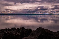 Just one man beneath the sky, just two ears, just two eyes (.KiLTЯo.) Tags: kiltro cl chile patagonia magallanes tierradelfuego lagoblanco water lake clouds sky color colour longexposure rocks calm nature landscape