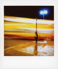 Brighton Ghost Bus 5 (tobysx70) Tags: fujifilm fuji instax share sp3 square instant film smartphone ipad mini wifi printer canon powershot s90 digital brighton ghost bus old steine east sussex england uk motion blur wet reflection night nocturnal street light lamp person shadow red yellow toby hancock photography