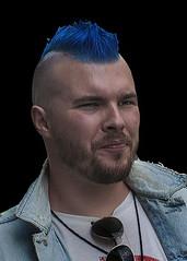 Portrait (D80_542934) (Itzick) Tags: candid copenhagen color colorportrait blue coloredhair man face facialexpression streetphotography shades goatee blackbackground portrait denmark d800 itzick