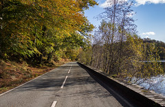 Autumn Roads (music_man800) Tags: autumn fall leaves trees woods woodlands colours colors colourful beautiful pretty scenery october blue orange green gold yellow lake llyn road roads wales snowdonia national park uk united kingdom outdoors outside natural light lighting sunny chilly cold shadows shade contrast canon 700d adobe lightroom creative cloud edit photography arty artistic landscape scene