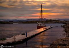 Sunset Sailing(Norway) (williamwalton001) Tags: pentaxart norway fishingboat pier sky stone harbour mountains sunset
