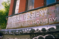 Ideal Hosiery (colinpoe) Tags: 6x9 manhattan vanishingny mediumformat streetphotography grafitti storefront newyorkcity ghostsign idealhosiery signage cinestill lowereastside nyc fujicag690 rangefinder street cinestill50 advertising les 120 fujica gothamist