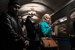 Standing Out (Ktoine) Tags: colour color blue green candid street blonde metro underground dark light bag telephone addict girl womain busy focus stand out moscow russia crowd