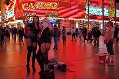 On The Strip (Rick Del Carmen) Tags: people city historicfremontlasvegas showgirls color menwomen streetphotography night streetperformers downtownlasvegas fremontstreet lasvegas