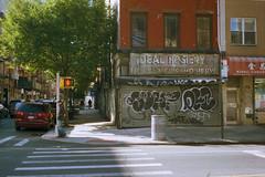 Ideal Corner (colinpoe) Tags: 6x9 manhattan vanishingny mediumformat streetphotography grafitti storefront newyorkcity ghostsign idealhosiery signage cinestill lowereastside nyc fujicag690 rangefinder street cinestill50 advertising les 120 fujica