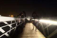 Salutations spectrales... (Tonton Gilles) Tags: alençon normandie photo de nuit fantômes spectres transparent transparence chapeau salutations pose longue passerelle parc la providence mise en scène réverbères lampadaires orange blanc paysage urbain rue