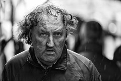 The stare (Frank Fullard) Tags: frankfullard fullard candid street portrait wild hair stare eye wisps black white blanc noir monochrome serious irish ireland face expression rain wet weather hairstyle