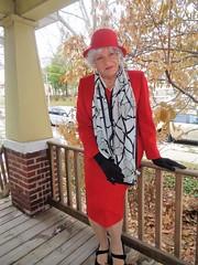 Over-Dressed? (Laurette Victoria) Tags: red suit porch silver scarf gloves laurette woman